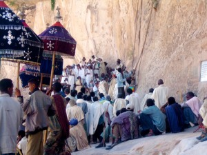 Mourners arrive with the coffin at Debre Demo Monastery, Ethiopia, Africa