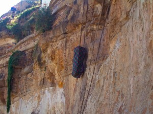 The coffin is hoisted up the rock face at Debre Demo Monastery, Ethiopia, Africa