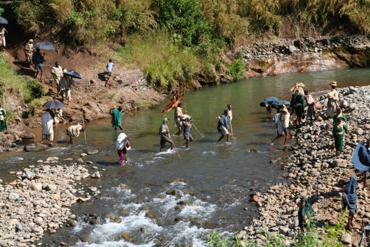 Crossing a river near the Blue Nile Waterfalls, Lake Tana, Bahir Dar, Ethiopia, Africa