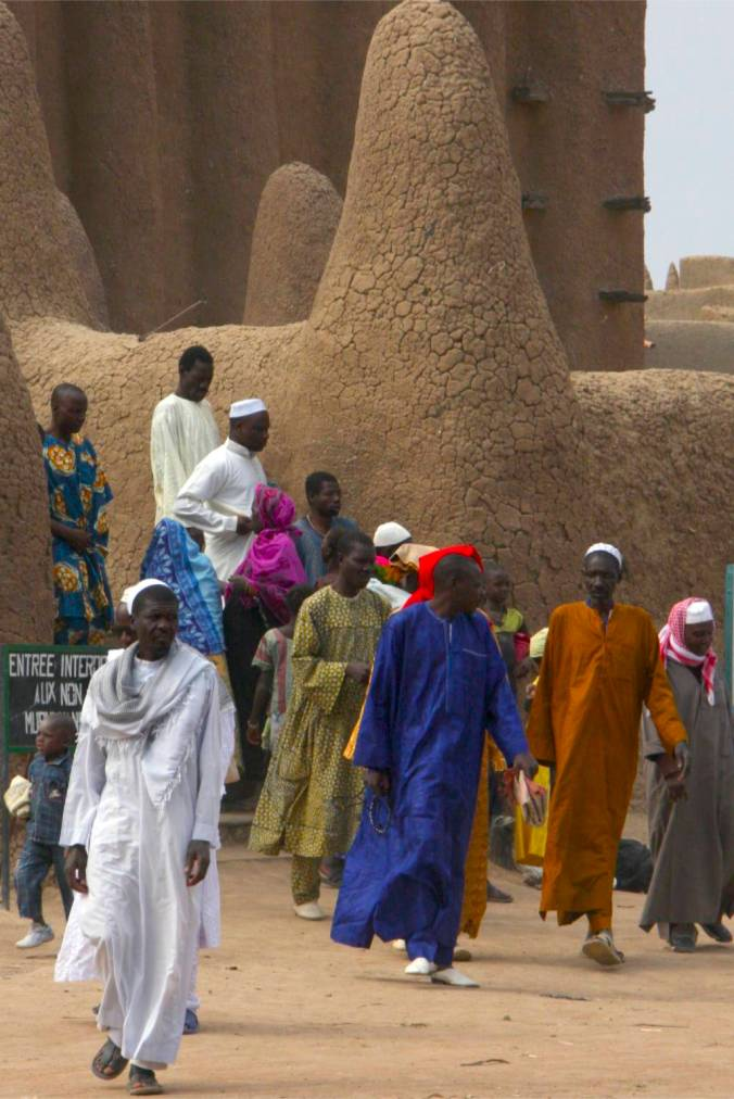 Worshippers leave the Grand Mosque in Djenne, Mali, Africa