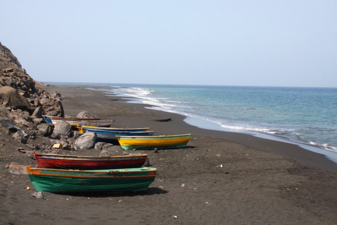 Boats of the black sand beach below São Filipe, Fogo, Cape Verde, Africa