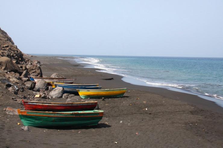 Boats of the black sand beach below São Filipe, Fogo, Cape Verde, Africa
