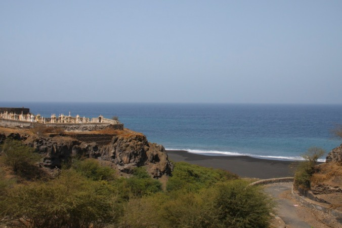 Cemetery and black sand beach below São Filipe, Fogo, Cape Verde, Africa