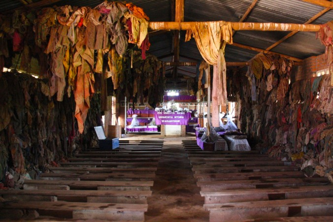 Interior of the church at the Ntarama Genocide Memorial site, the clothes are those of people killed in the church, Rwanda, Africa