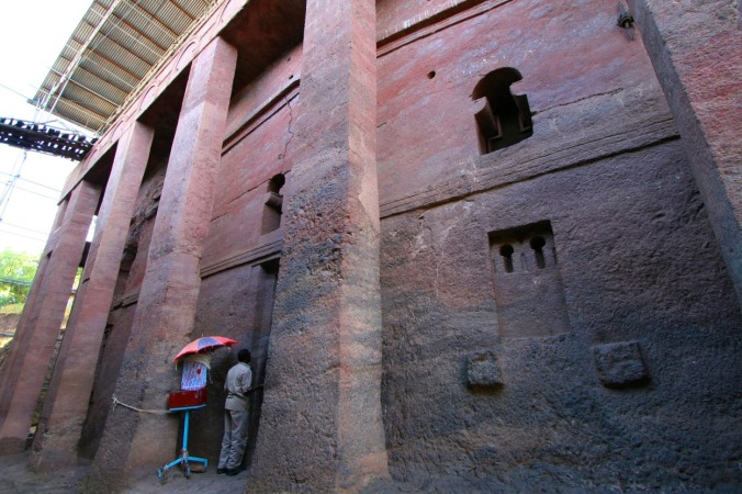 A man prays outside a rock-hewn church, Lalibela, Ethiopia, Africa