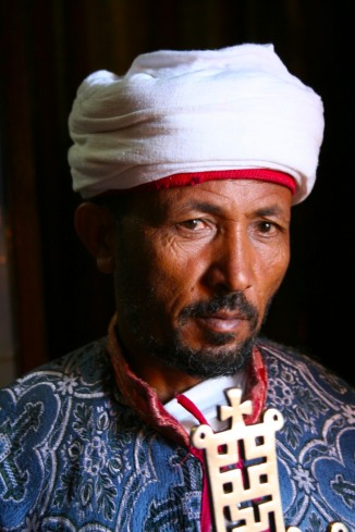 Priest with Ethiopian Orthodox cross, Lalibela, Ethiopia, Africa