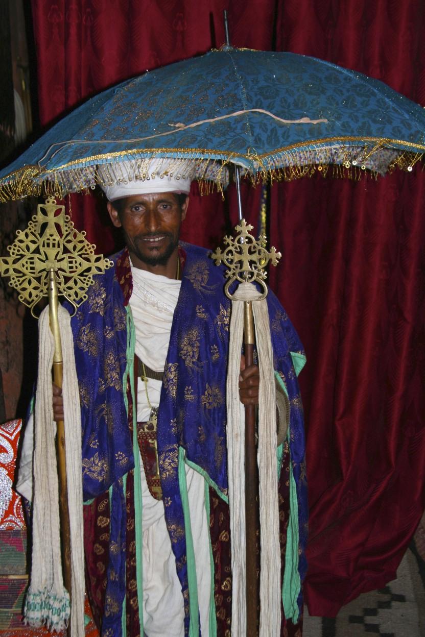 Priest With Ethiopian Orthodox Cross And Umbrella
