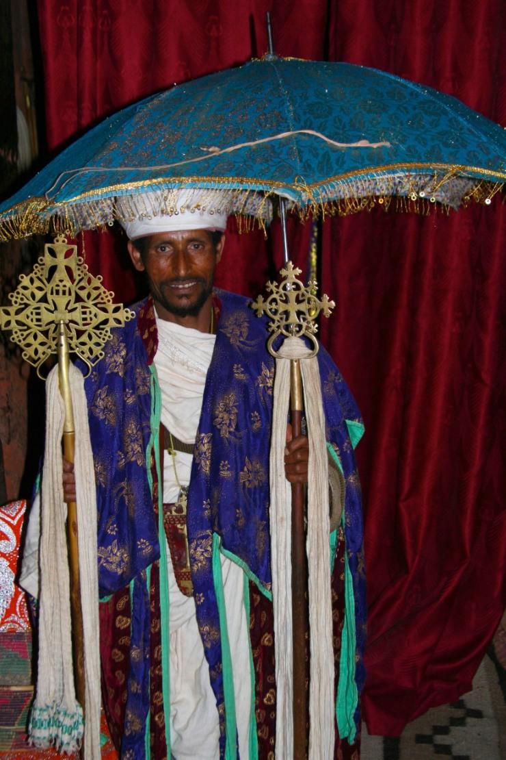 Priest with Ethiopian Orthodox cross and umbrella, Lalibela, Ethiopia, Africa