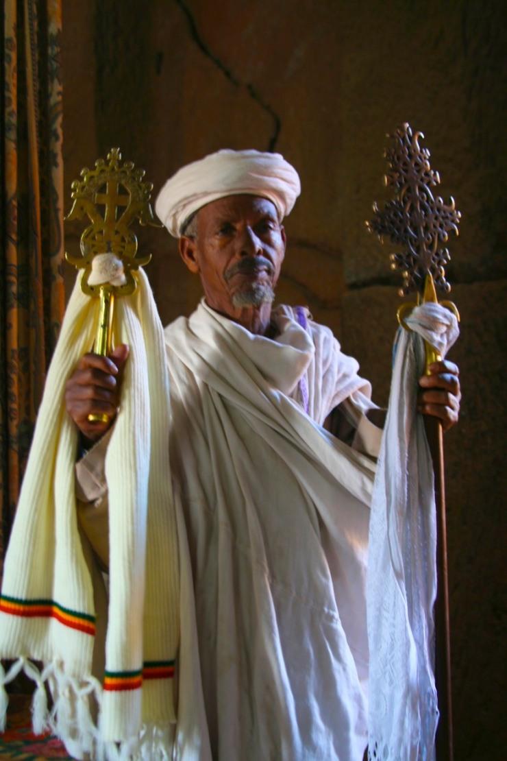 Priest with Ethiopian Orthodox cross, Lalibela, Ethiopia, Africa