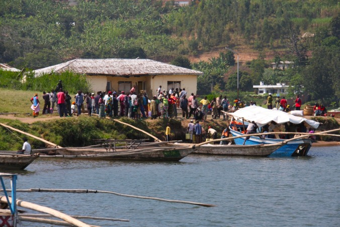People board a boat, Lake Kivu near Gisenyi, Rwanda, Africa