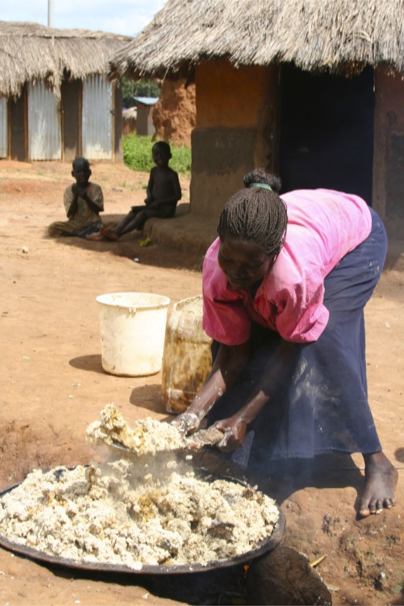 Woman makes beer, Internal Displacement Camp, Gulu, Uganda, Africa