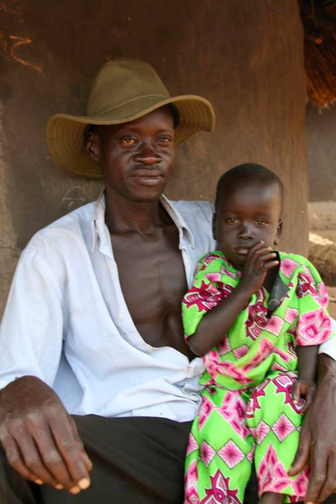 Man and child, Internal Displacement Camp, Gulu, Uganda, Africa