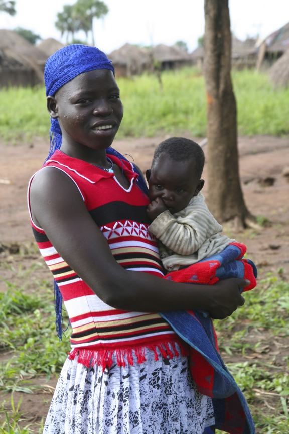 Young woman and baby, Internal Displacement Camp, Gulu, Uganda, Africa