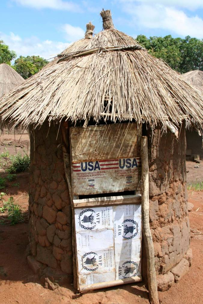 USAID and WFP toilet door, Internal Displacement Camp, Gulu, Uganda, Africa