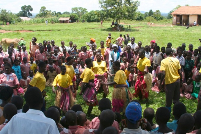 A crowd gathers to see an educational play, Iganga, Uganda, Africa
