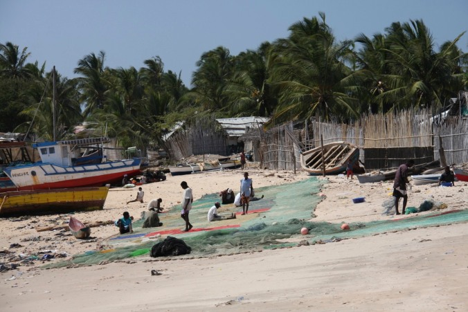 Repairing fishing nets, Pemba, Mozambique