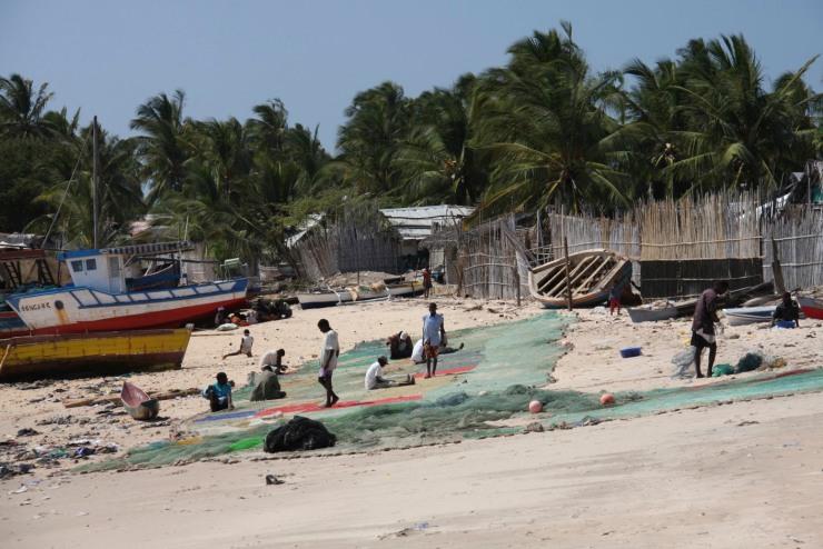 Repairing fishing nets, Pemba, Mozambique
