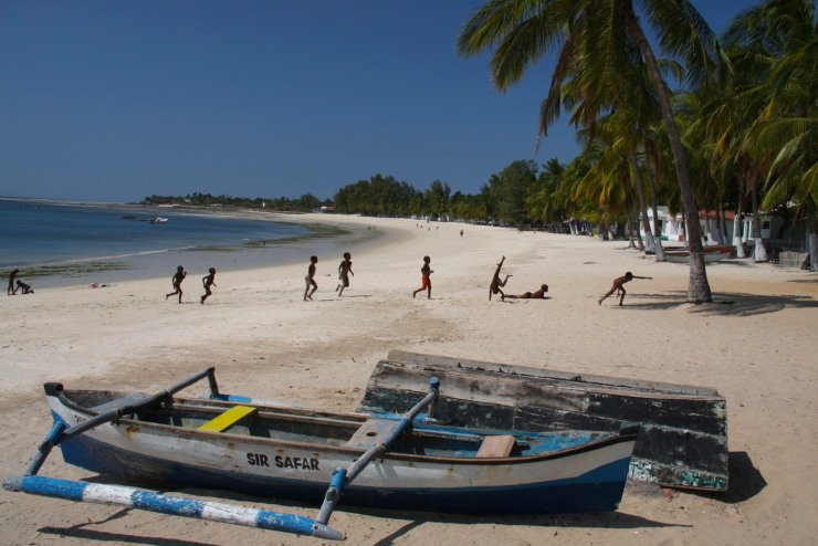 Boats and children on Wimbe Beach, Pemba, Mozambique, Africa