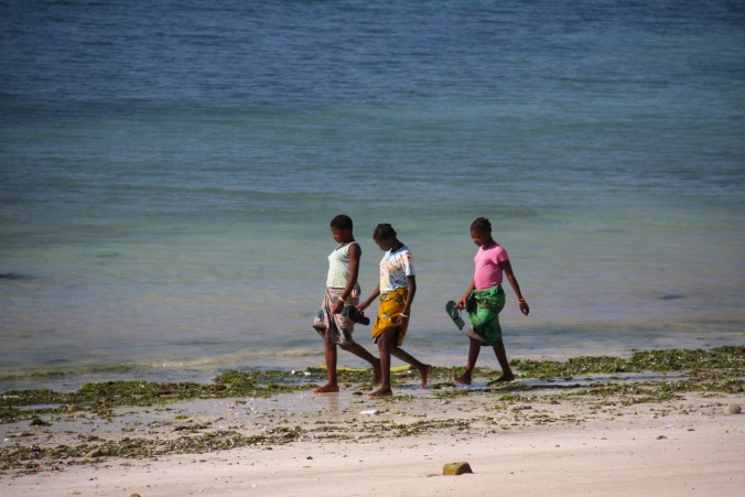 Girls walk on Wimbe Beach, Pemba, Mozambique, Africa