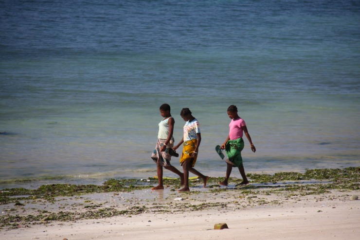 Girls walk on Wimbe Beach, Pemba, Mozambique, Africa