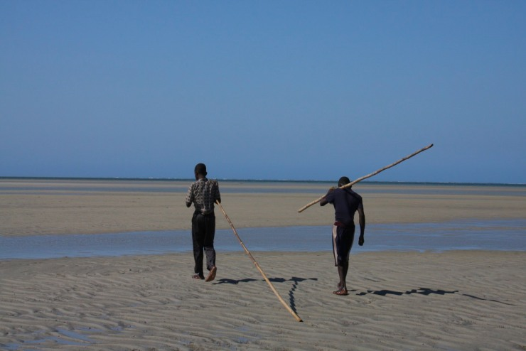 Our guides walking back to Ibo, Quirimbas Archipelago, Mozambique, Africa