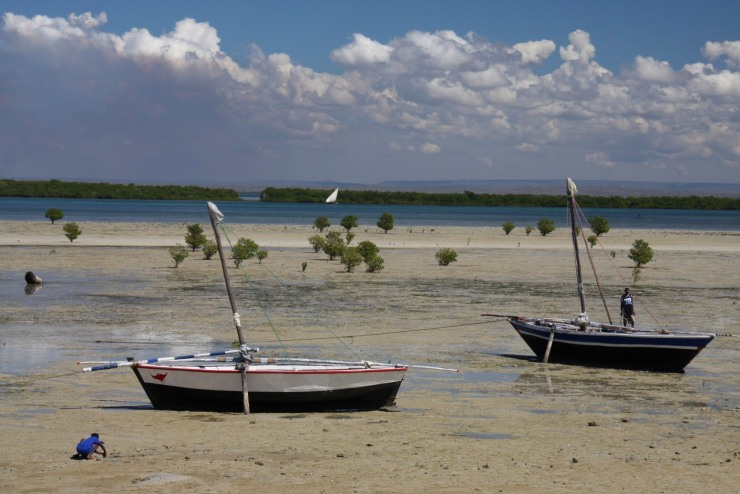 People and boats on the beach, Ibo Island, Mozambique, Africa