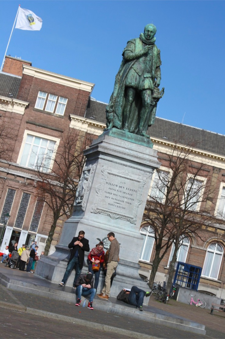 Statue and people in the Plein, The Hague, Netherlands