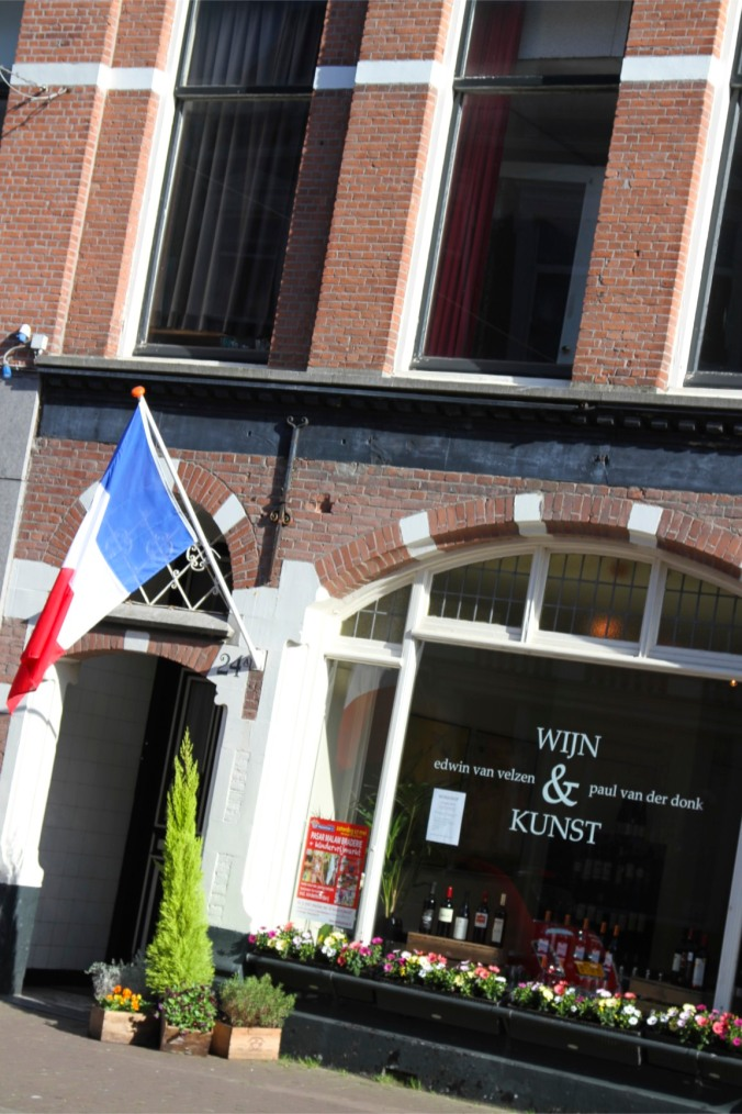 Dutch flag outside a shop, The Hague, Netherlands