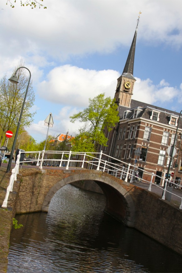 Canal and church in old Delft, Netherlands