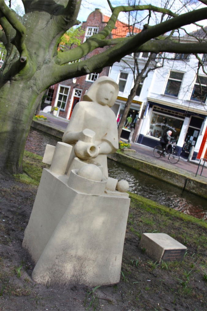 Statue of a woman making Delft pottery, Delft, Netherlands