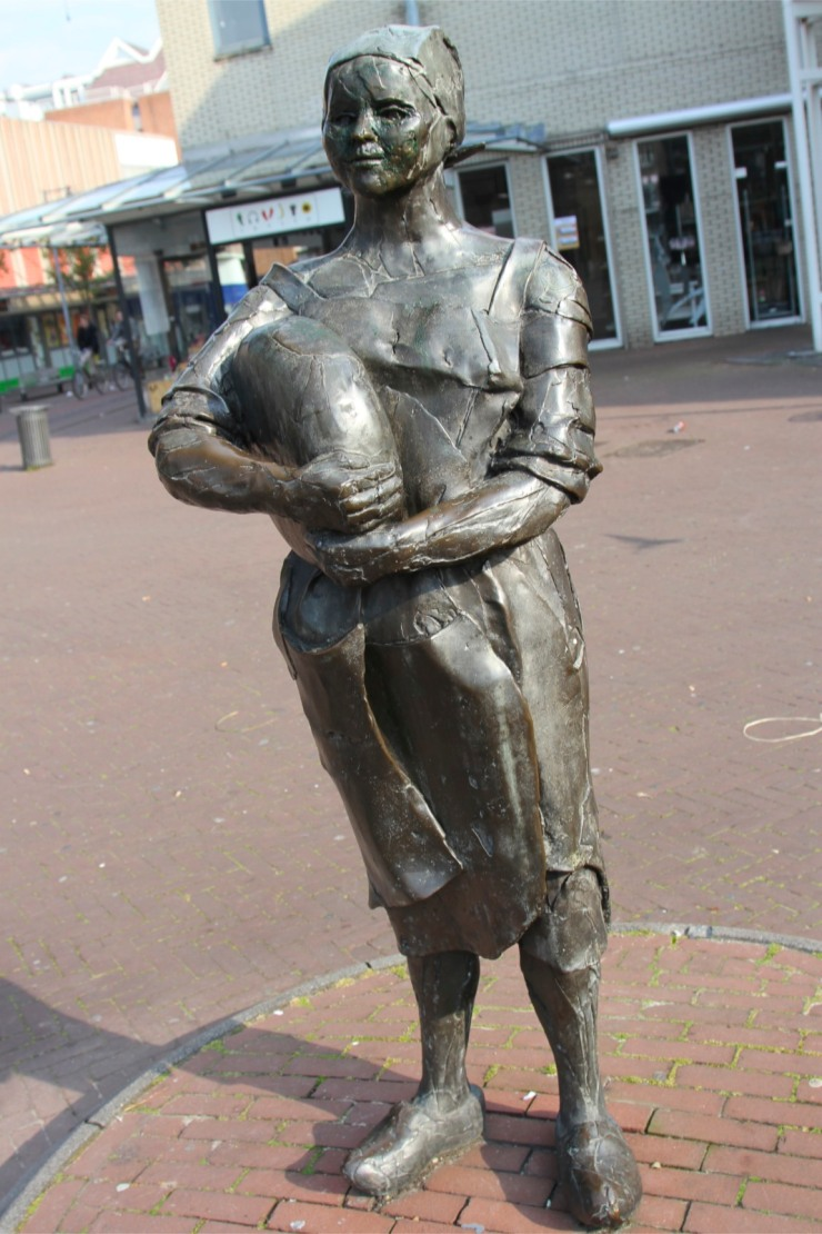 Statue of a woman with a Gouda cheese, Gouda, Netherlands
