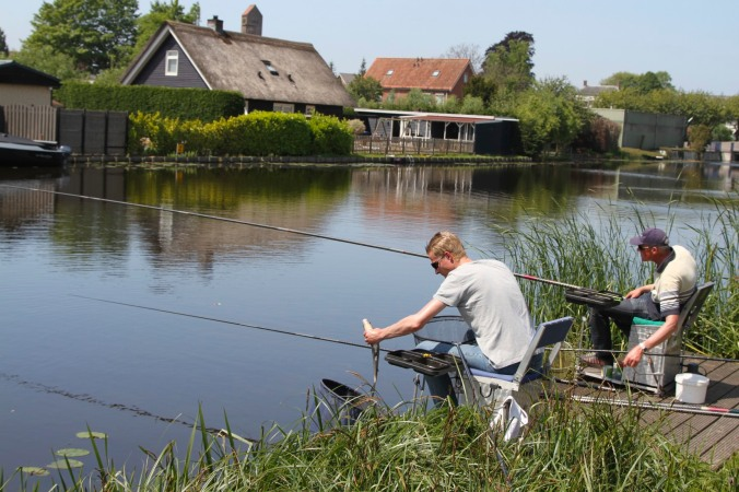 Fishermen with fish at Kinderdijk, Netherlands