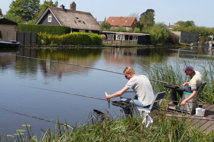 Fishermen with fish at Kinderdijk, Netherlands