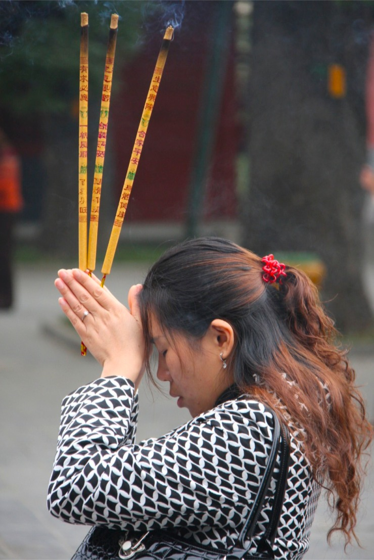 Worshipers at Yonghe Gong Buddhist temple, Beijing, China