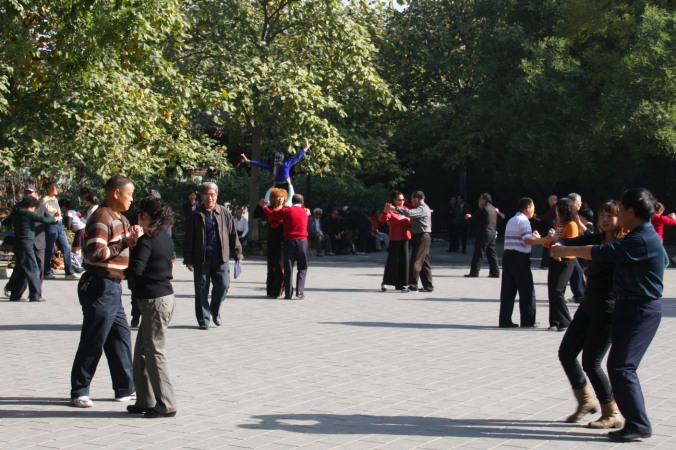 People dancing at The Summer Palace, Beijing, China