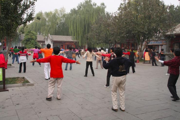 Flashmob exercising in Beihai Park, Beijing, China
