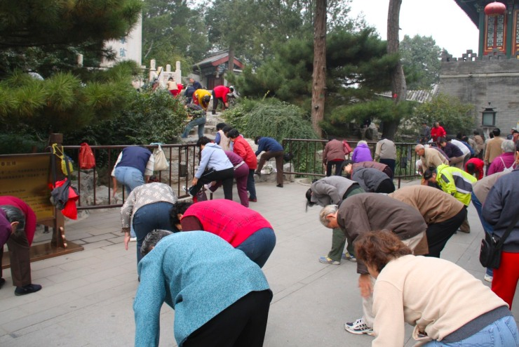 Flashmob exercising in Beihai Park, Beijing, China
