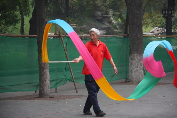 Flag dancing in Beihai Park, Beijing, China