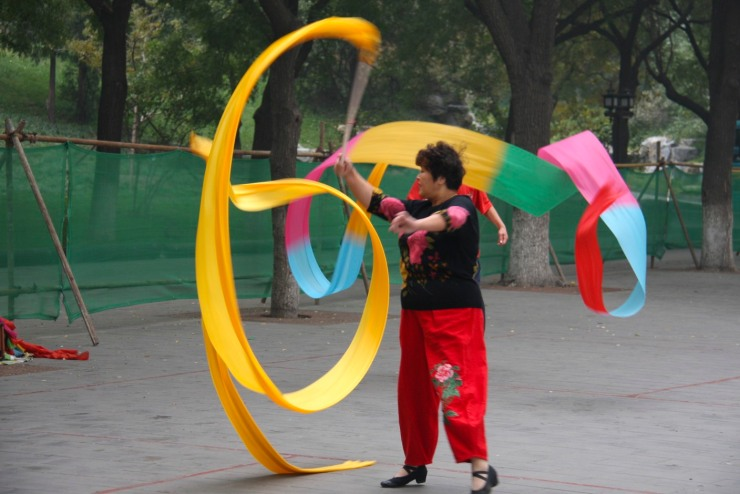 Flag dancing in Beihai Park, Beijing, China