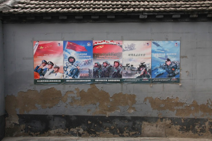 Military recruiting posters in a hutong, Beijing, China