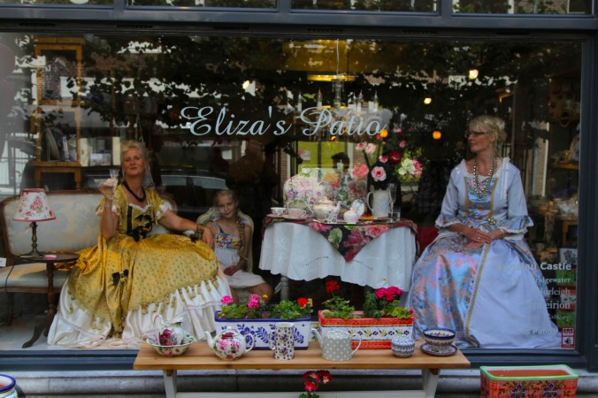 Women role playing in a shop window, Leiden, Netherlands