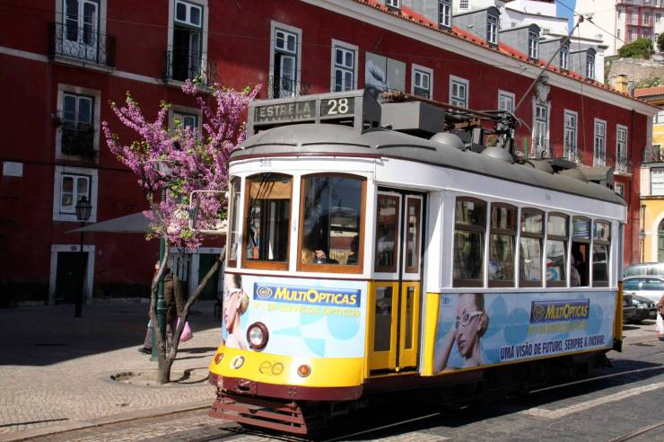 Yellow tram on the streets of Lisbon, Portugal