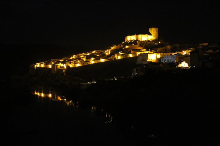 Mertola at night, reflected in the Rio Guadiana, Portugal