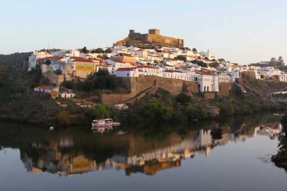 Mertola reflected in the Rio Guadiana, Portugal