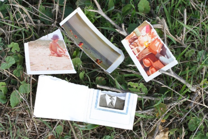 Ripped up photographs at Cabo Espichel, Portugal