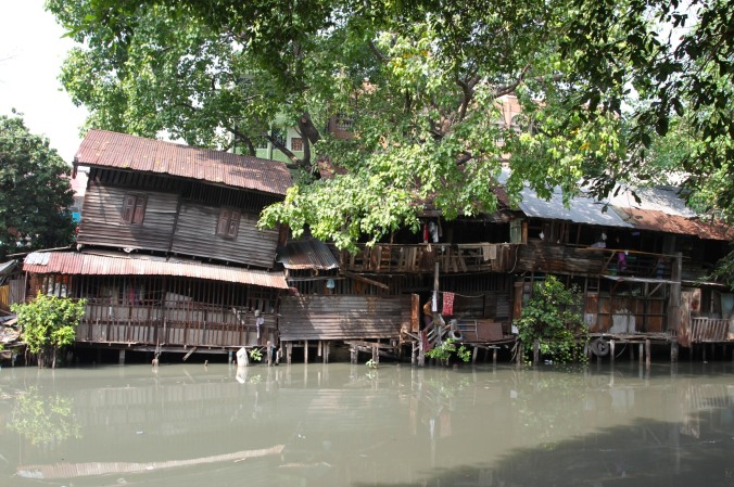 Typical houses by a canal, Bangkok, Thailand