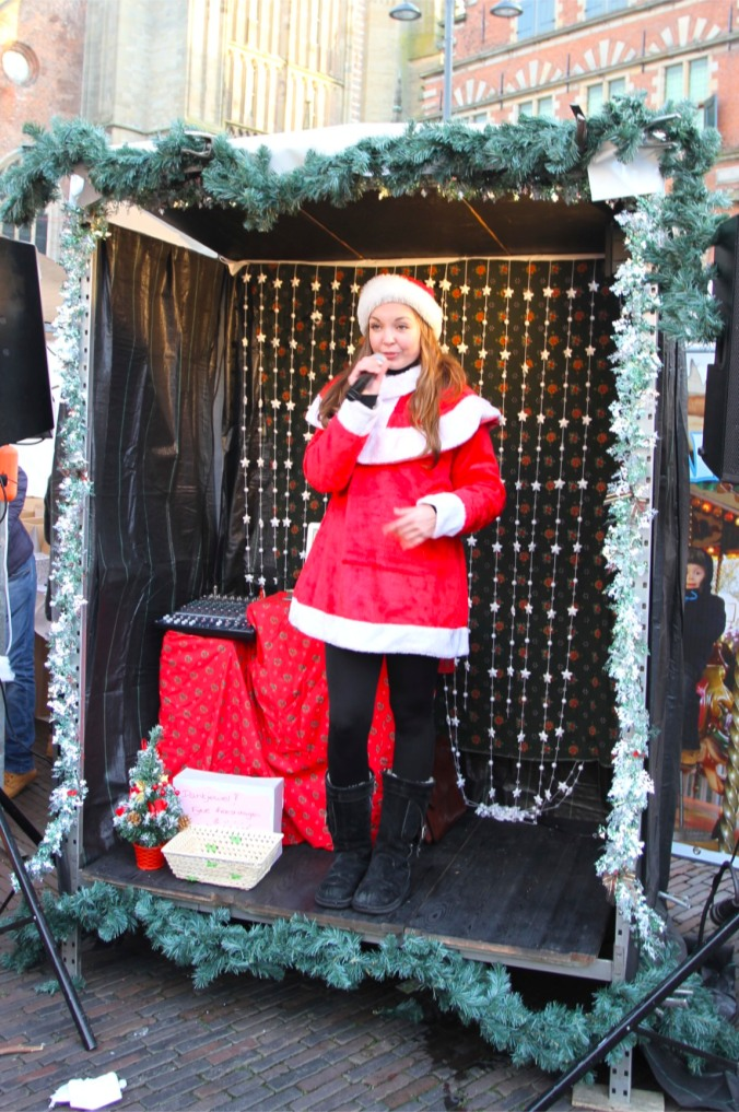 Lone singer at Haarlem Christmas Market, Netherlands