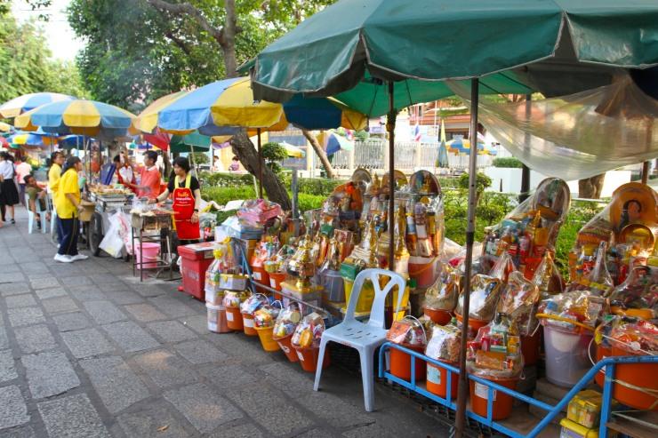 Prayer offerings outside a Buddhist temple, Bangkok, Thailand