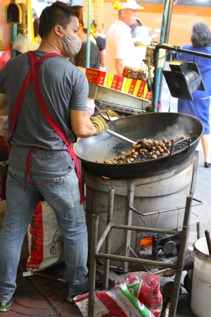 Roasting chestnuts, Chinatown, Bangkok, Thailand