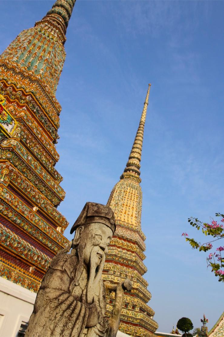 Stone Guard and Royal Chedi at Wat Pho, Bangkok, Thailand
